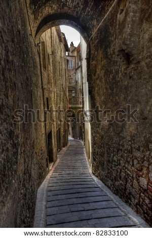 Alley in a small village in Tuscany, Italy