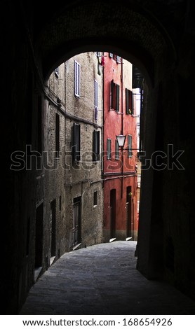 Alley in a typical Italian town, Tuscany, Italy