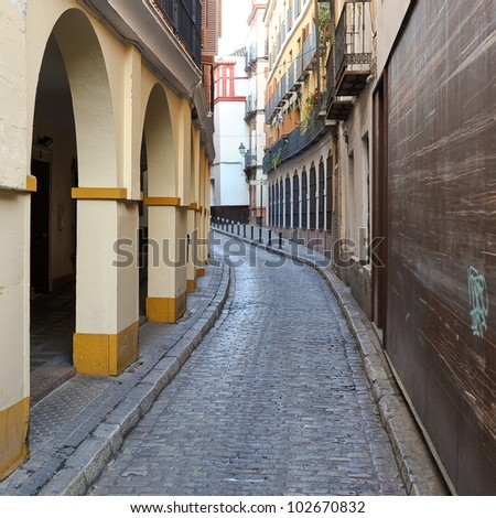 Alley in Seville, Spain. - stock photo