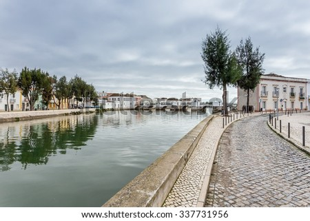 Alley near the river to the center of the town of Tavira. - stock photo