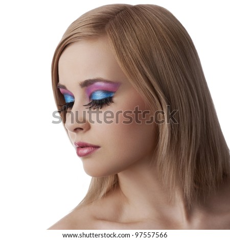 alluring beauty portrait of blond young girl with her make up in color and hair style isolated over white background