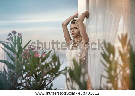 Alluring blond woman relaxing in the tropics