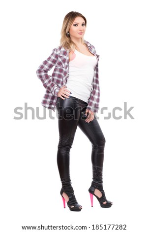 Alluring blonde wearing checked shirt and black pants. Isolated on white - stock photo