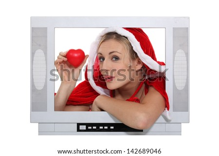 alluring mother Christmas advertising for TV set - stock photo