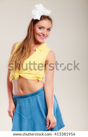 Alluring seductive pretty pin up girl with hairband bow. Attractive gorgeous young retro woman posing in studio. - stock photo