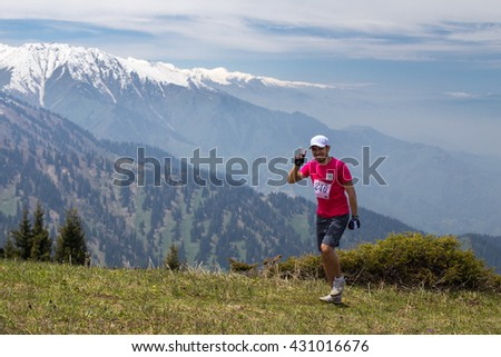 ALMATY, ALMATY DISTRICT,KAZAKHSTAN - MAY 22, 2016: Open competition SKY RUNNING 2016held in Eliksay gorge. Man runs up to the mountain participating in the competition
