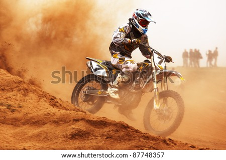 "ALMATY, KAZAKHSTAN - APRIL 10: A.Tindikov (7) participates at Motocross competition ""Fabrichny Cup""- Open Championship of Kazakhstan, on April 10, 2011 in Almaty, Kargaly, Kazakhstan. - stock photo"