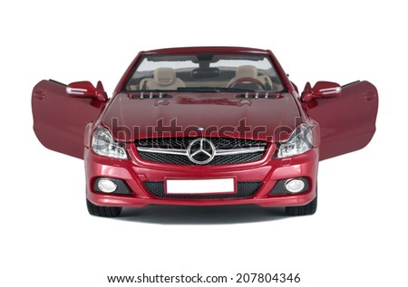 ALMATY, KAZAKHSTAN -APRIL 21, 2014: Collectible toy red Mercedes-Benz SL 550 cabriolet  front view with open doors isolated on white background - stock photo