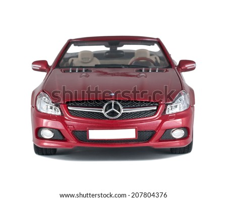 ALMATY, KAZAKHSTAN - APRIL 21, 2014: Collectible toy red Mercedes-Benz SL 550 cabriolet front view isolated on white background - stock photo