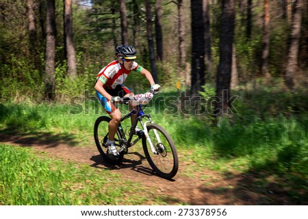 "ALMATY, KAZAKHSTAN - APRIL 19, 2015: D.Abdurahmanov (N6) in action at cross-country competition ""Open season - Bikes relay 2015""  - stock photo"