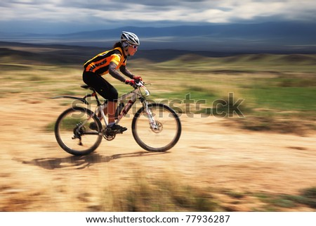 "ALMATY, KAZAKHSTAN - APRIL 30: G.Balagurova (N28) in action at Adventure mountain bike cross-country marathon in mountains ""Jeyran Trophy 2011"" on April 30, 2011 in Almaty, Kazakhstan. - stock photo"