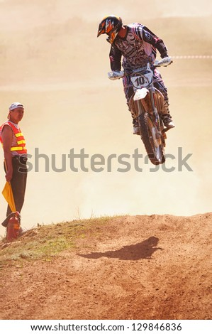 """ALMATY, KAZAKHSTAN - APRIL 22 K.Gavrilov (N10) at the Motocross competition """"Fabrichny Cup""""- Open Championship of Kazakhstan on April 22, 2012 in Almaty, Kazakhstan. - stock photo"""