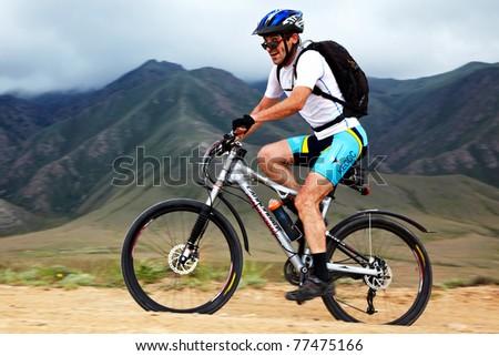 "ALMATY, KAZAKHSTAN - APRIL 30: O.Jukov (N38) in action at Adventure mountain bike cross-country marathon in mountains ""Jeyran Trophy 2011"" April 30, 2011 in Almaty, Kazakhstan. - stock photo"