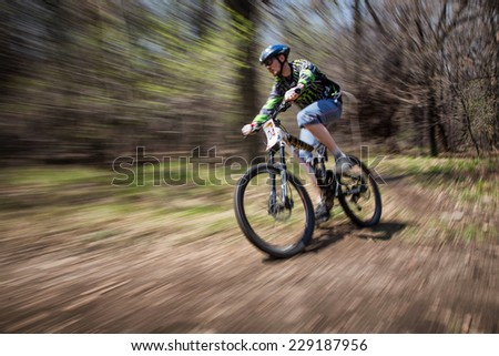"ALMATY, KAZAKHSTAN - APRIL 19, 2014: S.Shramkov (N4) in action at cross-country competition ""Open season - Bikes relay 2014""  - stock photo"