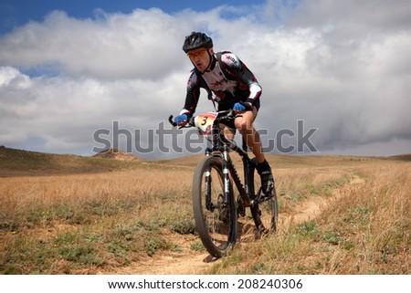 "ALMATY, KAZAKHSTAN - APRIL 30: V.Philipchuk (N3) in action at Adventure mountain bike cross-country marathon in mountains ""Jeyran Trophy 2011"" April 30, 2011 in Almaty, Kazakhstan. - stock photo"