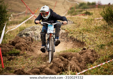 ALMATY, KAZAKHSTAN - AUGUST 22, 2015: I.Krasovsky (N33) in action at Mountain Bike sports event DOWNHILL EXTREME WEEKEND.  - stock photo