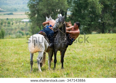 ALMATY, KAZAKHSTAN - JULY 26 : Audaryspak, a traditional Kazakh horseback wrestling game. on July 26, 2015 in Almaty, Kazakhstan.