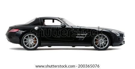 ALMATY, KAZAKHSTAN - June 22, 2014 - Collectible toy Mercedes-Benz SLS Sedan isolated on white background - stock photo