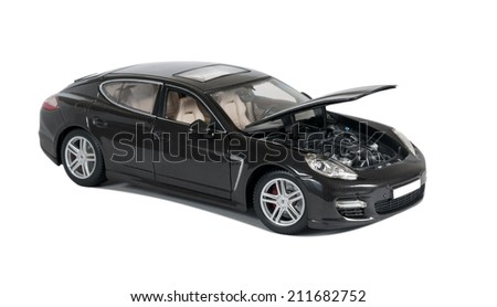 Almaty, Kazakhstan - 10 March 2014: Collectible toy car Porsche Panamera Turbo with open hood on a white background - stock photo