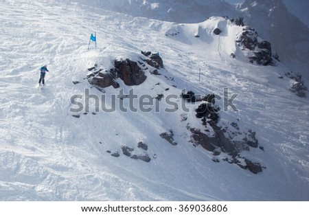 "ALMATY, KAZAKHSTAN, MARCH 15, 2015: Competition ""Shymbulak Off-piste Challenge"", moment of the race"