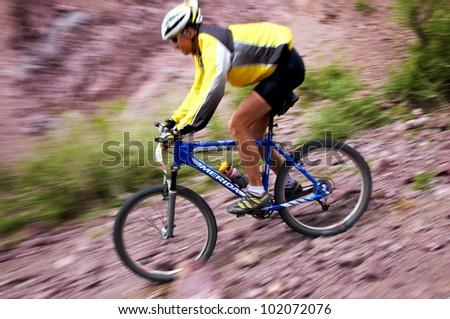 "ALMATY, KAZAKHSTAN - MAY 01: A.Baynauskas (N19) in action at Adventure mountain bike cross-country marathon in mountains ""Jeyran Trophy 2012"" May 01, 2012 in Almaty, Kazakhstan. - stock photo"