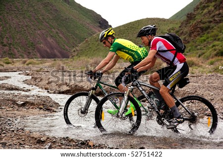 "ALMATY, KAZAKHSTAN - MAY 1: E.Janabaev (right) and M.Sheynikov in action at Adventure mountain bike cross-country marathon in mountains ""Jeyran Trophy 2010"" May 1, 2010 in Almaty, Kazakhstan. - stock photo"