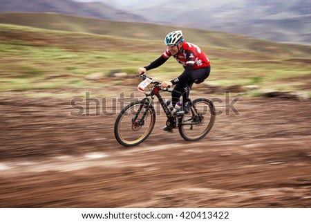 "ALMATY, KAZAKHSTAN - MAY 02, 2016: E.Kazantcev (N25) in action at Adventure mountain bike cross-country competition in mountains ""Jeyran Trophy 2016"""