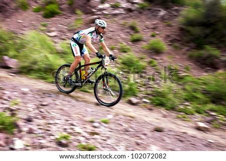 "ALMATY, KAZAKHSTAN - MAY 01: K.Rachyk (N25) in action at Adventure mountain bike cross-country marathon in mountains ""Jeyran Trophy 2012"" May 01, 2012 in Almaty, Kazakhstan. - stock photo"