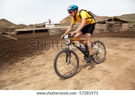 "ALMATY, KAZAKHSTAN - MAY 1: M.Dzolba (N12) in action at Adventure mountain bike cross-country marathon in mountains ""Jeyran Trophy 2010"" May 1, 2010 in Almaty, Kazakhstan. - stock photo"