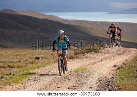 "ALMATY, KAZAKHSTAN - MAY 01: N.Eleusizov (N12) in action at Adventure mountain bike cross-country marathon in mountains ""Jeyran Trophy 2011"" May 1, 2011 in Almaty, Kazakhstan. - stock photo"