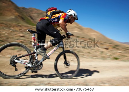 "ALMATY, KAZAKHSTAN - MAY 2: S.Yshkov (N87) in action at Adventure mountain bike cross-country marathon in mountains ""Jeyran Trophy 2011"" on May 2, 2011 in Almaty, Kazakhstan. - stock photo"
