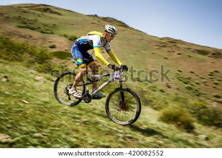 "ALMATY, KAZAKHSTAN - MAY 01, 2016: V.Ganja (N11) in action at Adventure mountain bike cross-country competition in mountains ""Jeyran Trophy 2016""  - stock photo"