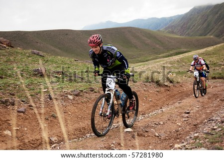 "ALMATY, KAZAKHSTAN - MAY 2: V.Karnushin (N2) in action at Adventure mountain bike cross-country marathon in mountains ""Jeyran Trophy 2010"" May 2, 2010 in Almaty, Kazakhstan. - stock photo"