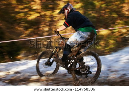 ALMATY, KAZAKHSTAN - NOVEMBER 06: Unknown rider in action at downhill mountain bike 'Pumpkin Race Mini DH. Halloween' November 06, 2011 in Almaty , Kazakhstan. - stock photo
