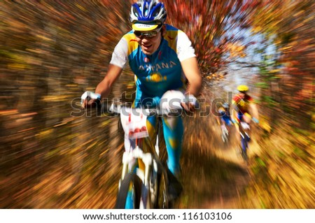 ALMATY, KAZAKHSTAN - OCTOBER 14: A.Anfinogenov (N15) in action at cross-country mountain bike 'Apple race' October 14, 2012 in Almaty, Kazakhstan. - stock photo
