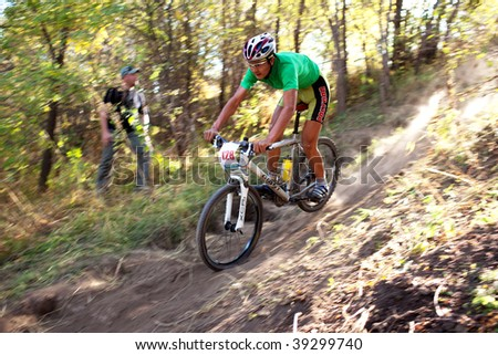 ALMATY, KAZAKHSTAN - OCTOBER 18: Nurbolat Kulimbetov in action at cross-country mountain bike 'Apple race' October 18, 2009 in Almaty , Kazakhstan. - stock photo