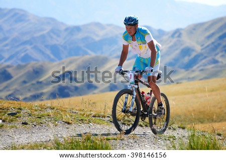 "ALMATY, KAZAKHSTAN - SEPTEMBER 04, 2011: E.Kazantsev (N7)  in action at Adventure mountain bike cross-country marathon in mountains ""Marathon Bartogay-Assy-Batan 2011"" - stock photo"