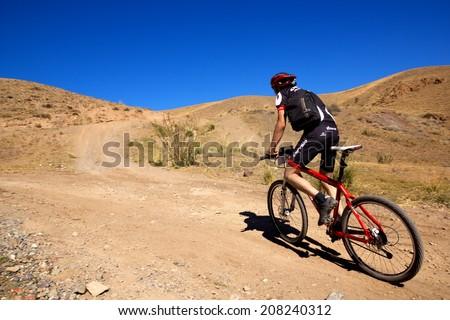 "ALMATY, KAZAKHSTAN - SEPTEMBER 09: J.Bakutbekuly (N14) in action at Adventure mountain bike cross-country marathon ""Marathon Bartogay-Assy-Batan 2012"" on September 09, 2012 in Almaty, Kazakhstan. - stock photo"