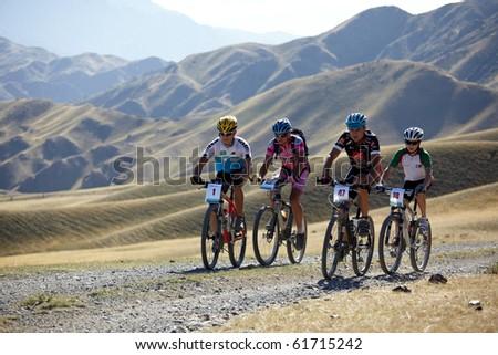 "ALMATY, KAZAKHSTAN - SEPTEMBER 05:K.Khzantcev(N1) and other in action at Adventure mountain bike cross-country marathon ""Marathon Bartogay-Assy-Batan 2010"" on September 05, 2010 in Almaty, Kazakhstan. - stock photo"