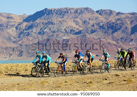 "ALMATY, KAZAKHSTAN - SEPTEMBER 13: Mountain bikers in action at Adventure mountain bike cross-country marathon ""Marathon Bartogay-Assy-Batan 2009"" on September 13, 2009 in Almaty, Kazakhstan. - stock photo"