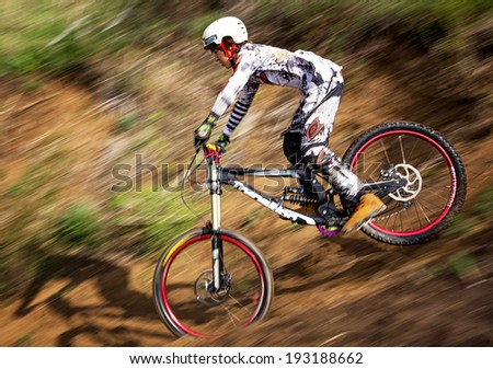 ALMATY, KAZAKSTAN - APRIL 27, 2014: Unknown rider in action at Mountain Bike sports event Downhill Koktybe.
