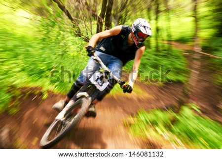 ALMATY, KAZAKSTAN - JUNE 30: A.Anfinogenov (N13) in action at  Mountain Bike sports event dedicated to the Day of the capital in Almaty, Kazakstan JUNE 30, 2013. - stock photo