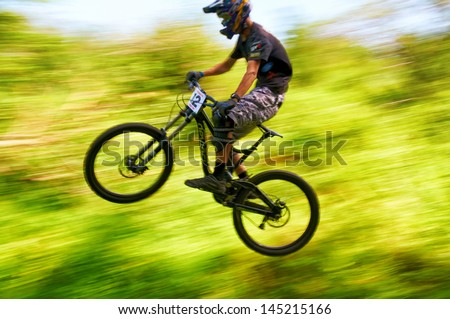 ALMATY, KAZAKSTAN - JUNE 30: D.Gafurov (N12) in action at  Mountain Bike sports event dedicated to the Day of the capital in Almaty, Kazakstan JUNE 30, 2013. - stock photo