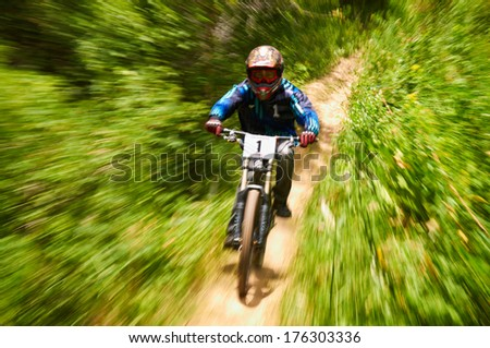 ALMATY, KAZAKSTAN - JUNE 30: Omargaliev (N1) in action at Mountain Bike sports event dedicated to the Day of the capital in Almaty, Kazakstan JUNE 30, 2013.  - stock photo