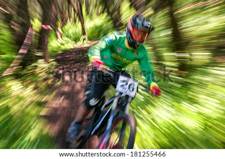 ALMATY, KAZAKSTAN - JUNE 30: S.Kagarov (N26) in action at Mountain Bike sports event dedicated to the Day of the capital in Almaty, Kazakstan JUNE 30, 2013.  - stock photo