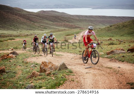 "ALMATY, KAZAKSTAN - MAY 02, 2015: A.Mihaylov (N2) in action at Adventure mountain bike cross-country marathon in mountains ""Jeyran Trophy 2015""  - stock photo"