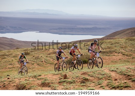 "ALMATY, KAZAKSTAN - MAY 02, 2014: Competitors in action at Adventure mountain bike cross-country marathon in mountains ""Jeyran Trophy 2014"""
