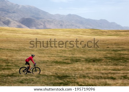 "ALMATY, KAZAKSTAN - MAY 02, 2014: E.Kornyakov (N25) in action at Adventure mountain bike cross-country marathon in mountains ""Jeyran Trophy 2014""  - stock photo"