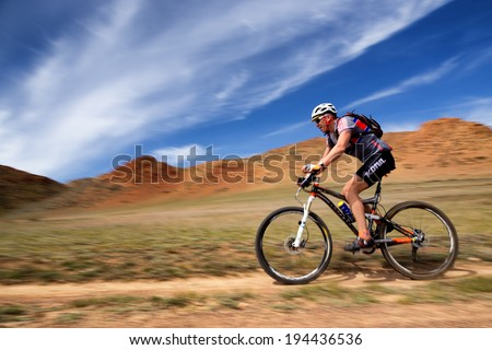 "ALMATY, KAZAKSTAN - MAY 01, 2014: M.Sotnikov(N15) in action at Adventure mountain bike cross-country marathon in mountains ""Jeyran Trophy 2014""  - stock photo"