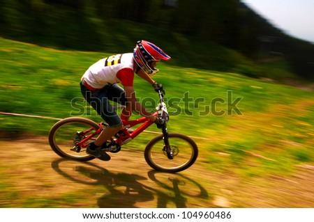 ALMATY, KAZAKSTAN - MAY 26: N.Janzakov (N23) in action at Freestyle Mountain Bike Session in Almaty, Kazakstan MAY 26, 2012. - stock photo